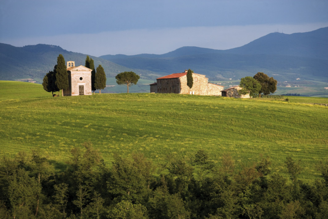 Val d'Orcia Tuscany Landscape with cypress trees and Chapel of Vitaleta with hills in the background