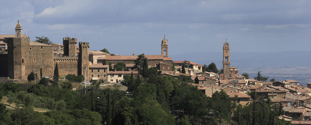 View of Montalcino with cypresse trees and bell towers